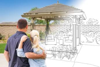 a blueprint coming to life in front of a couple | Bendigo Carports