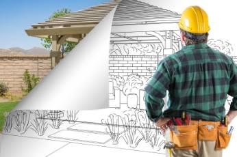 an architect looking at a Bendigo Carports blueprint